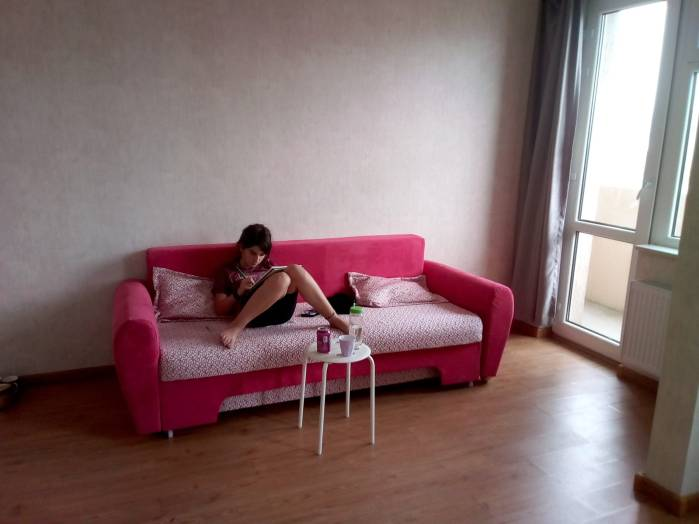 This is my home: My daughter reading on the sofa shortly after we bought it.
